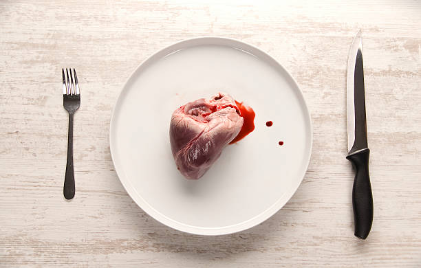 Pork heart on a white plate stock photo