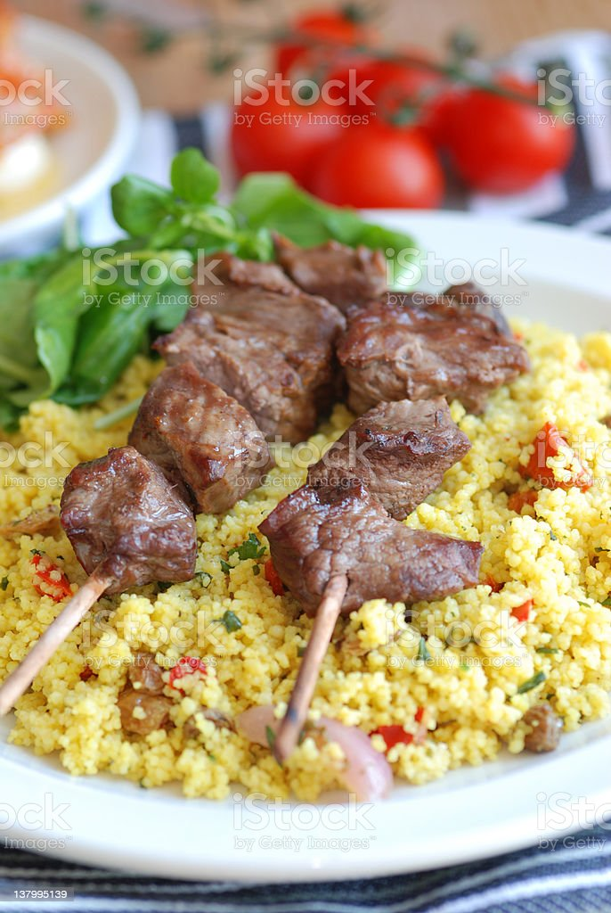 Pork kebabs with couscous royalty-free stock photo