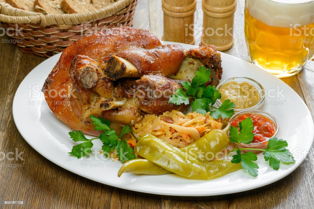 Pork knuckle and beer stock photo
