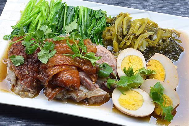 Pork leg brown stewed on dish stock photo