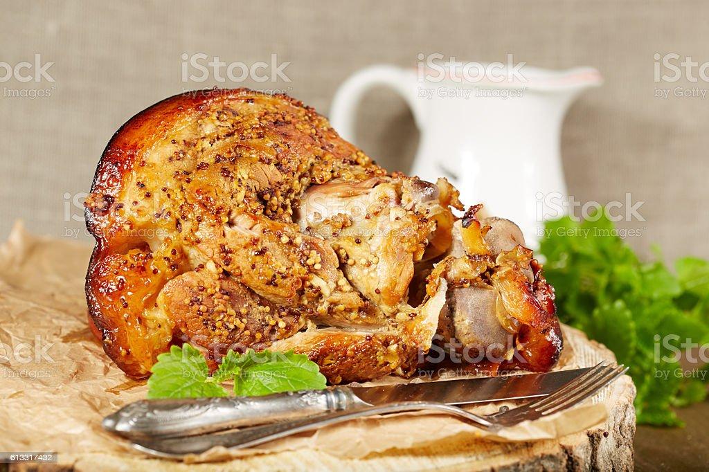 Pork leg roasted with mustard stock photo