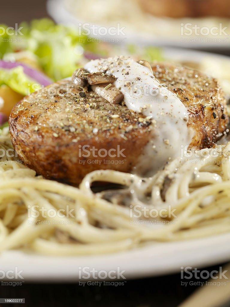 Pork Loin Chop with Creamy Mushroom Linguine royalty-free stock photo