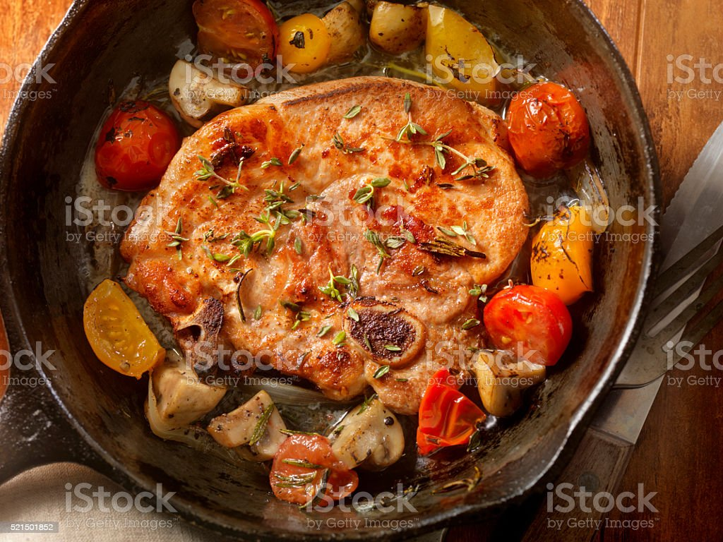 Pork Loin Chops with Tomatoes and Mushrooms stock photo