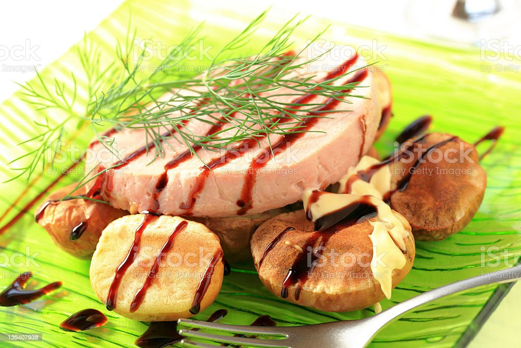 Pork loin steak and baked potatoes royalty-free stock photo