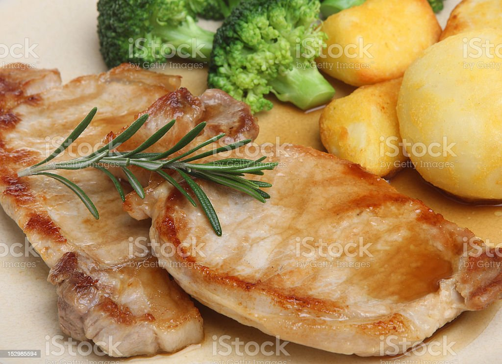 Pork Loin Steaks with Vegetables royalty-free stock photo