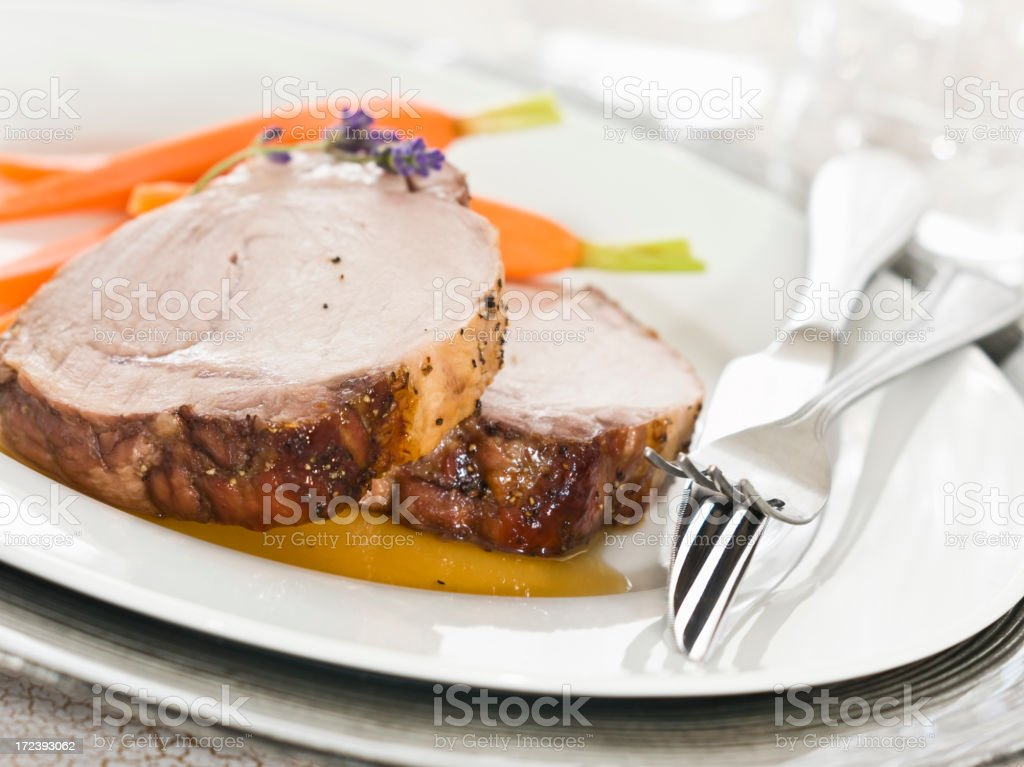 pork loin with white balsamic demi-glace stock photo