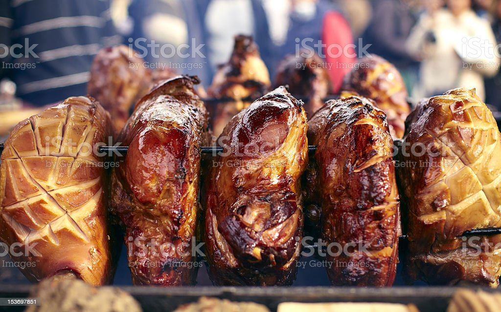 Pork meat roasting on a spit royalty-free stock photo