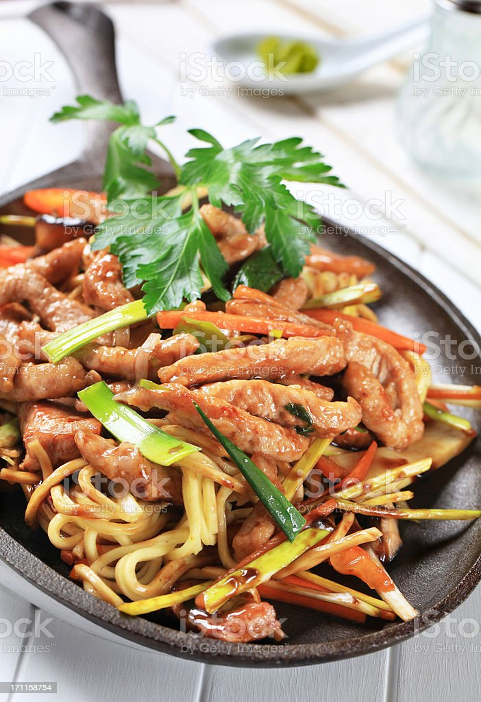 Pork meat stripes with fried vegetables stock photo