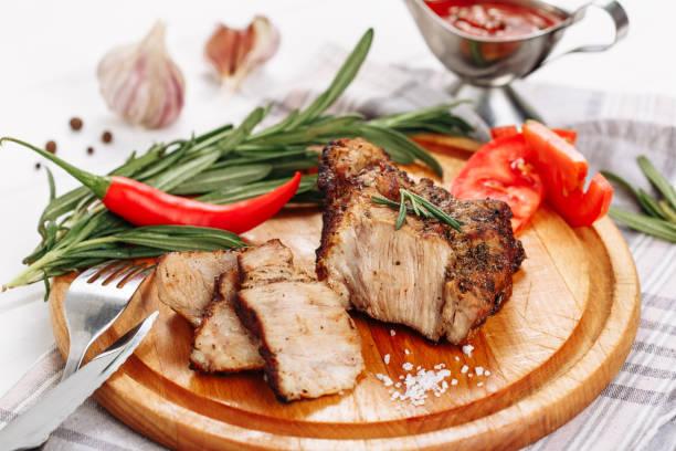 Pork Meat Tenderloin Roast on Wooden Board Side stock photo