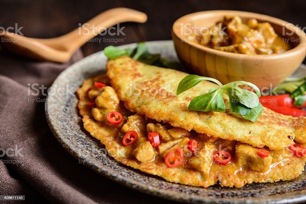 Pork meat with chili sauce in a potato pancake stock photo
