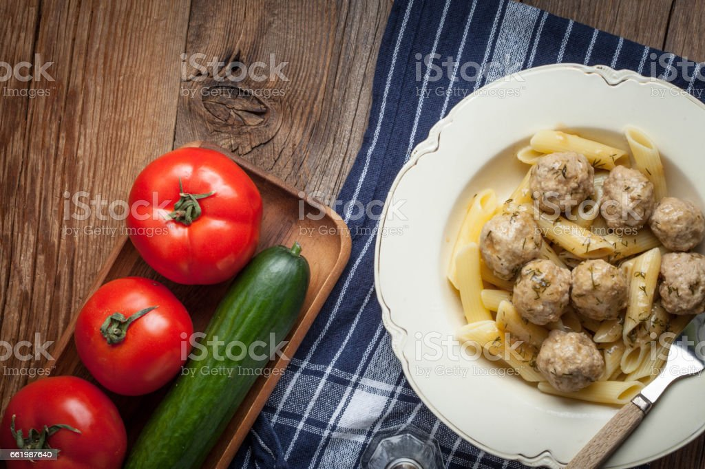 Pork meatballs with dill sauce and pasta. royalty-free stock photo