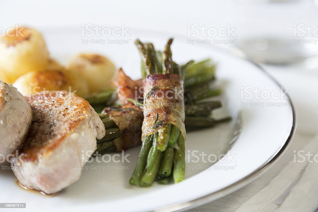 Pork medallions with potatoes and beans royalty-free stock photo