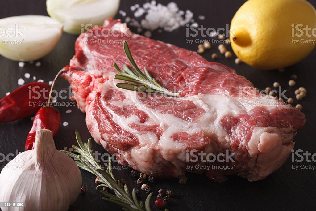 pork neck raw and ingredients macro on slate board. Horizontal stock photo