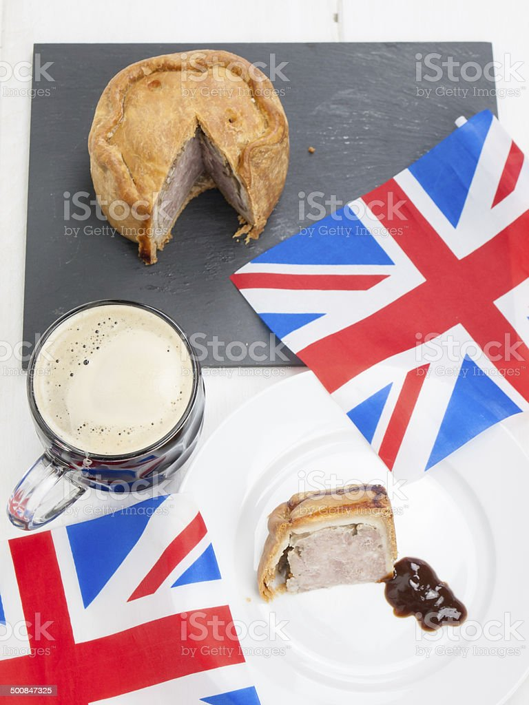 pork pie and beer with flags stock photo