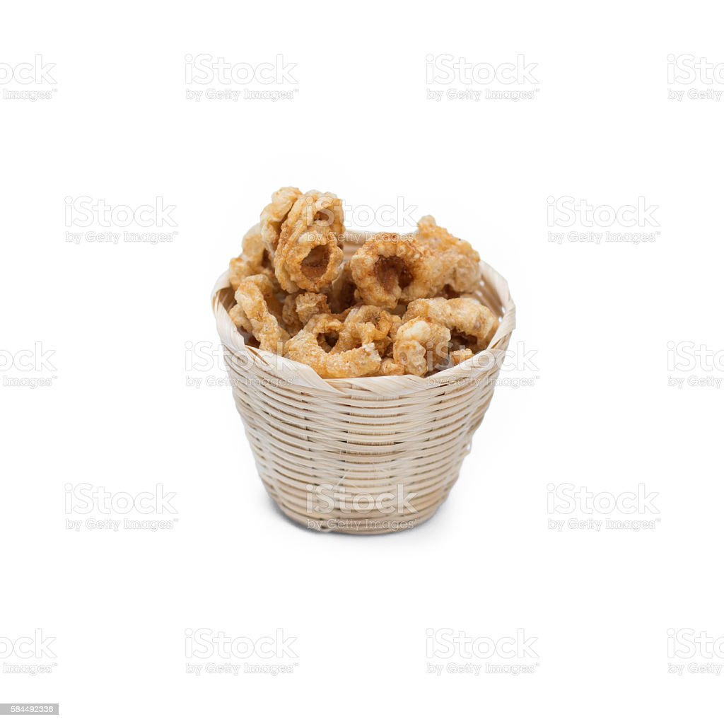 Pork rind in bamboo basket isolated on white stock photo