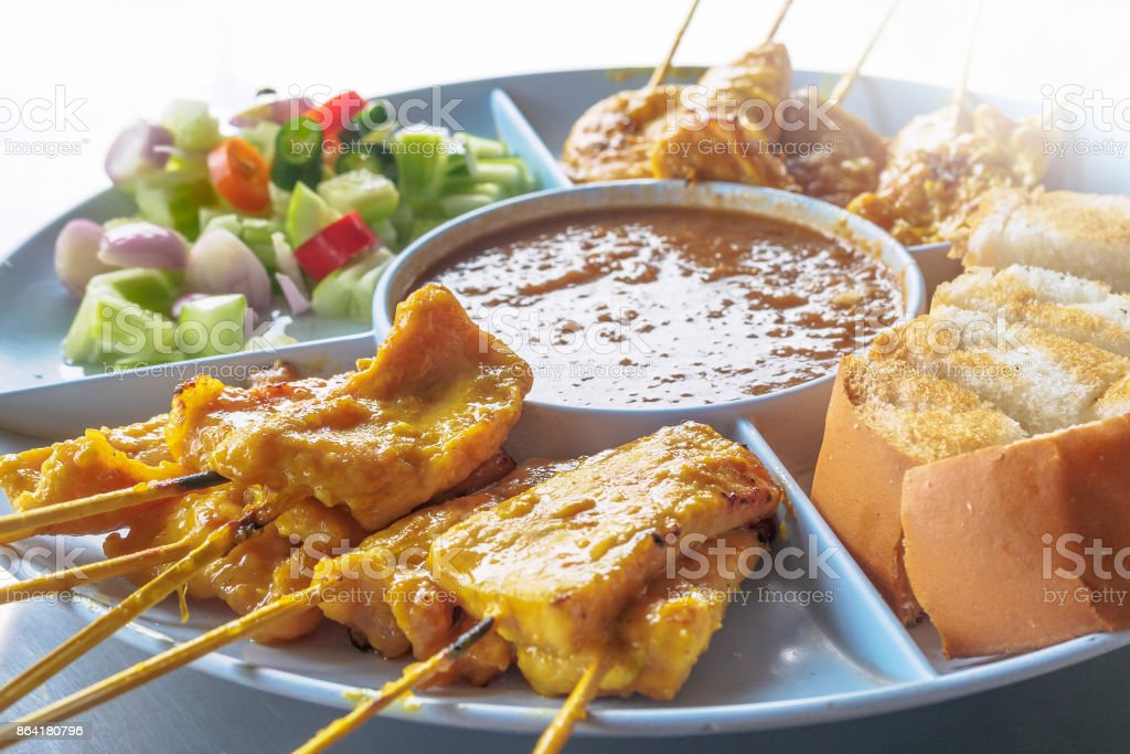 Pork satay,Grilled pork served with peanut sauce or sweet and sour sauce, Thai food royalty-free stock photo