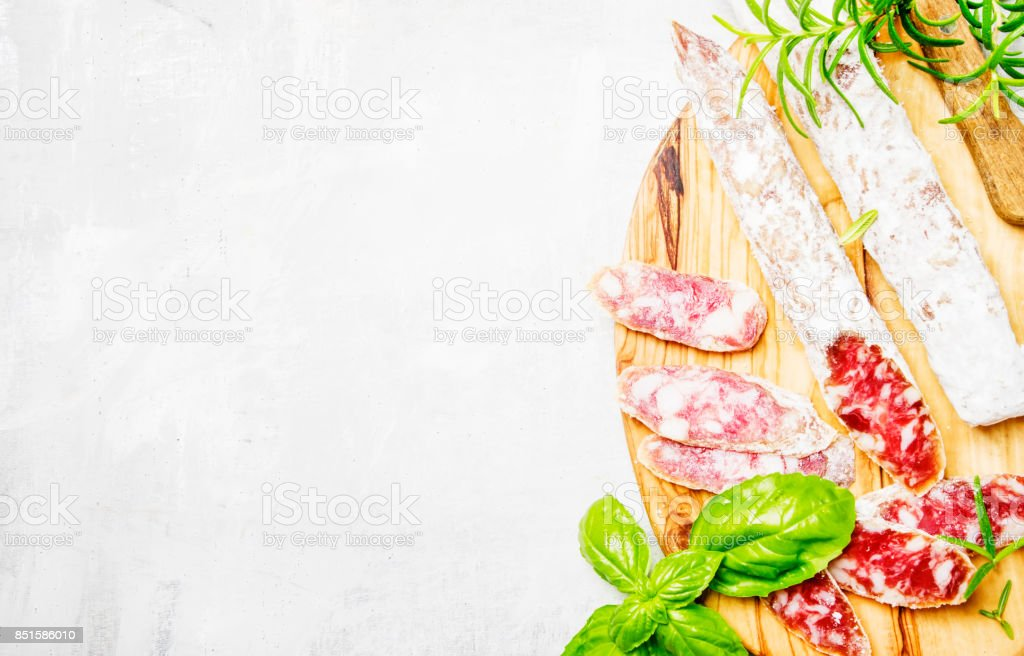 Pork sausages with rosemary and basil stock photo