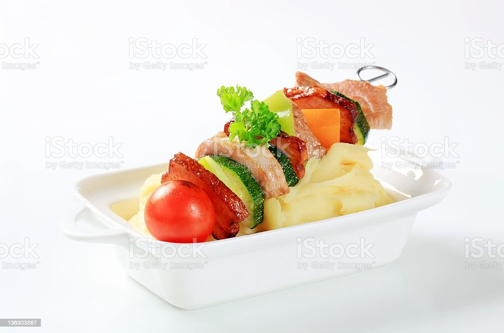 Pork skewer and mashed potato royalty-free stock photo
