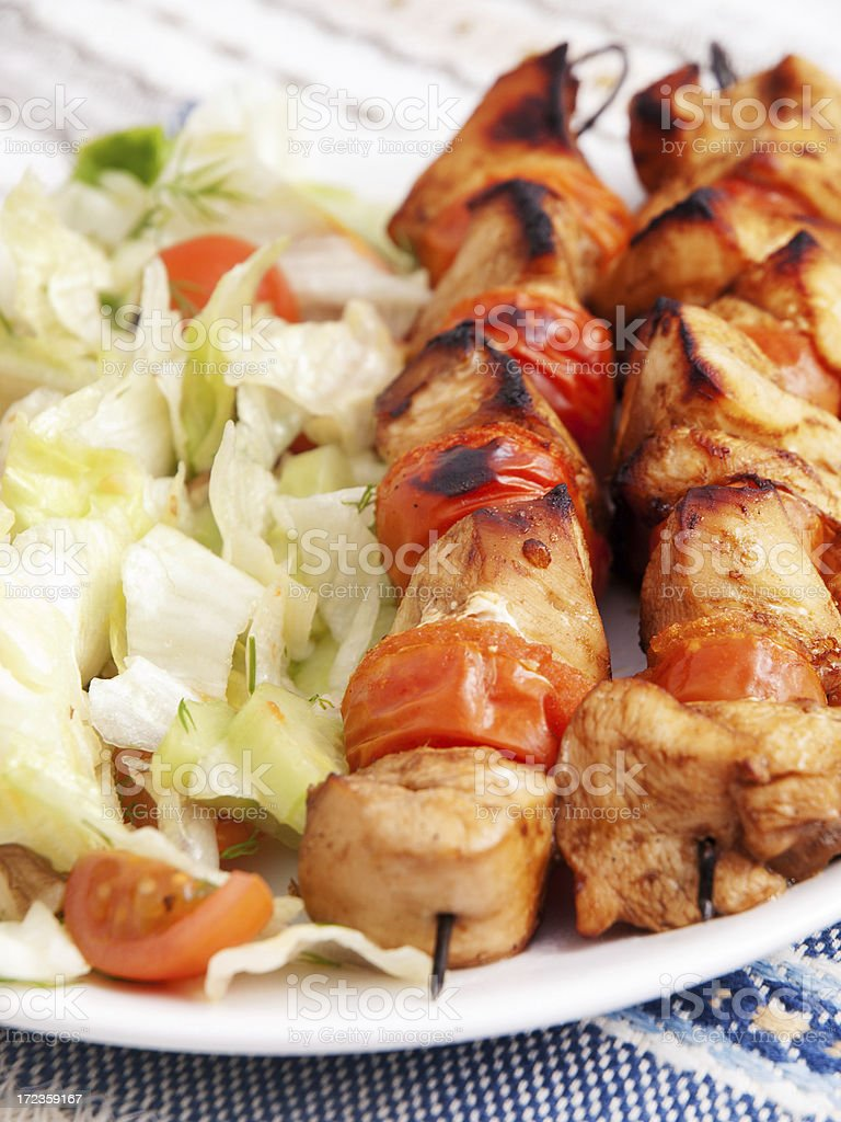 Pork skewers with salad royalty-free stock photo