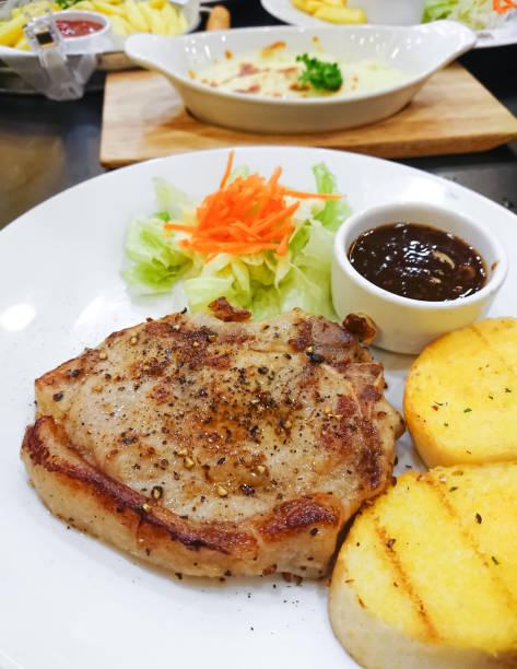 Pork Steak Marinated Black Pepper and Thai spicy Sauce stock photo