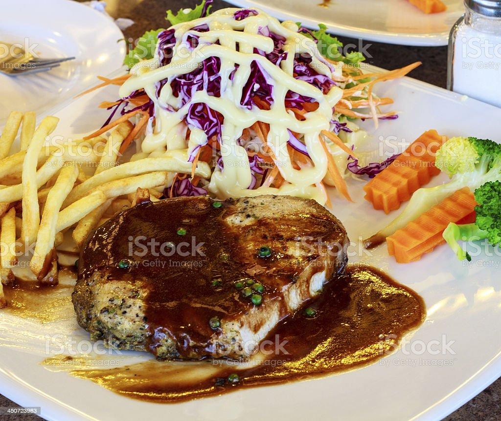 Pork steak with black pepper. royalty-free stock photo