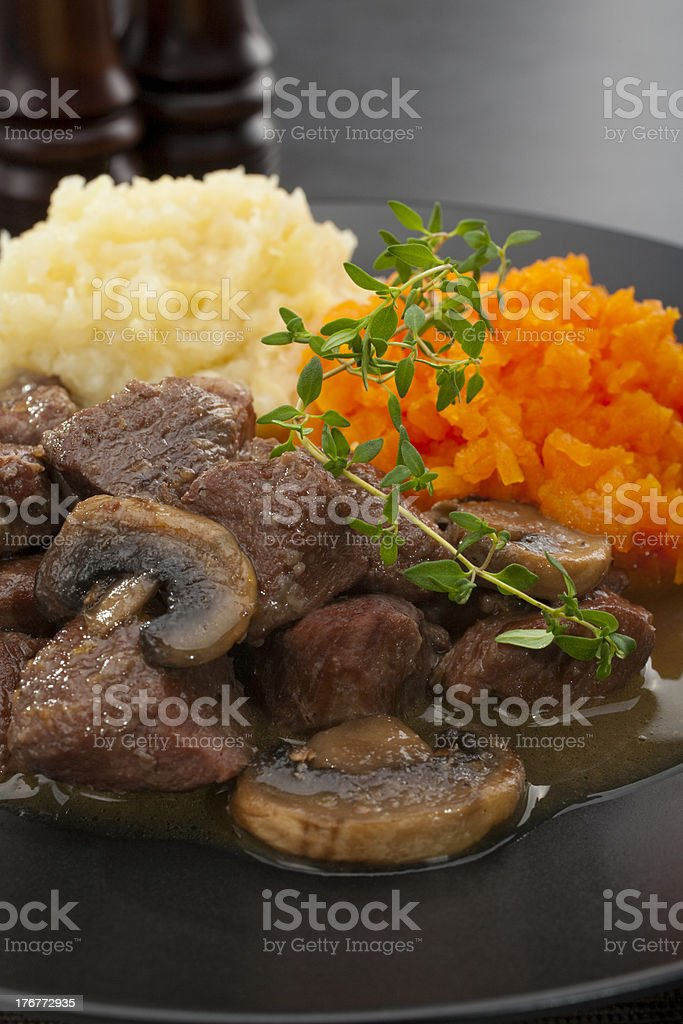 Pork Stew with Celeriac and Carrot Mash royalty-free stock photo