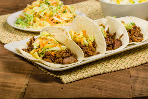 Pork tacos on a white serving plate stock photo