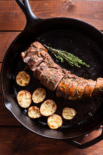 Pork Tenderloin with Roasted Potatoes and Thyme in a Cast Iron Skillet
