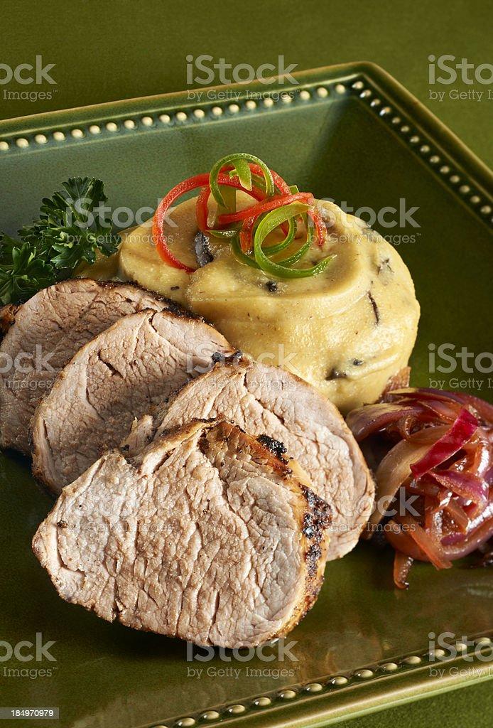 Pork Tenderloin with Mushroom polenta stock photo