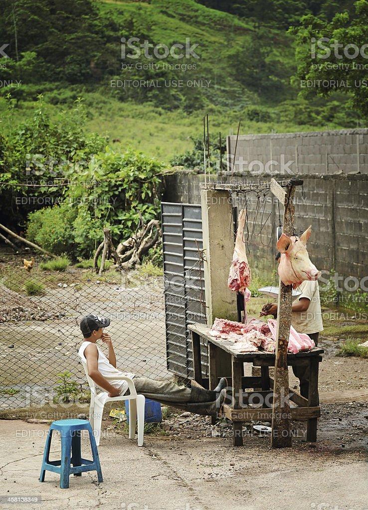 Pork Vendor At Butcher Stand royalty-free stock photo