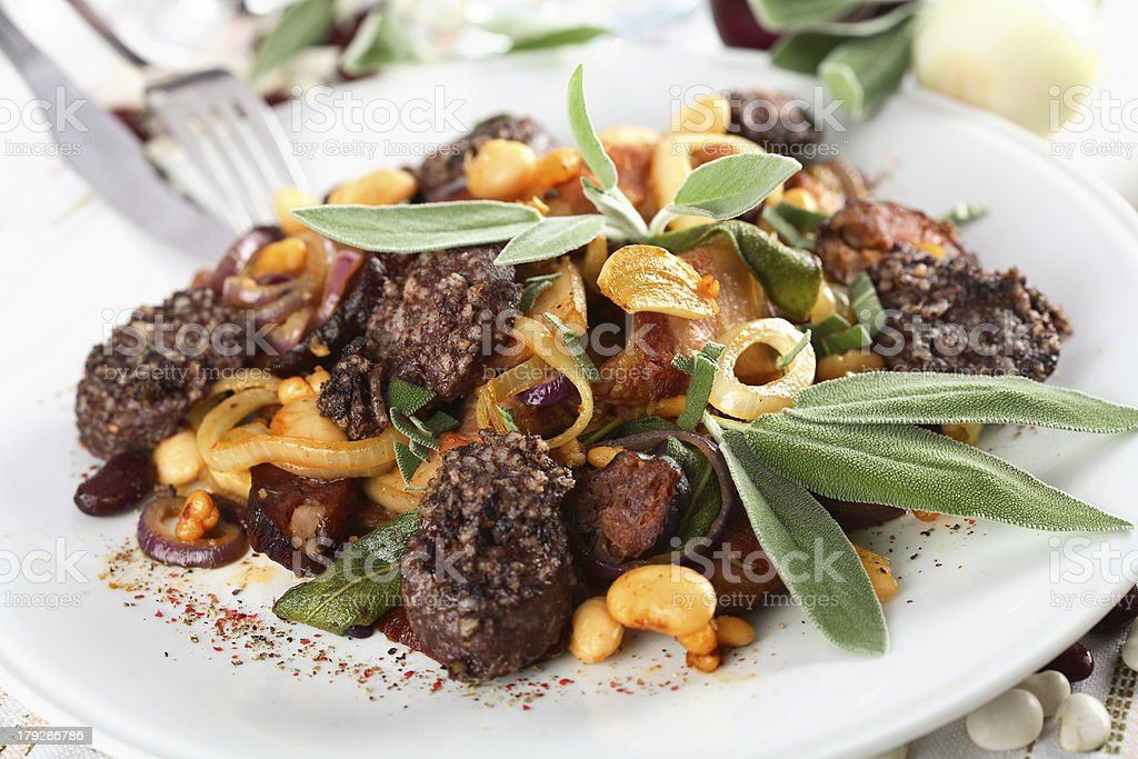 Pork with beans and herbs royalty-free stock photo