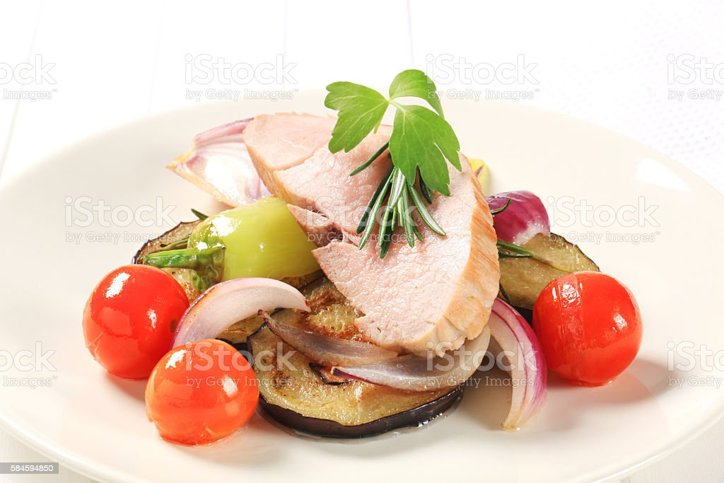pork with pan fried vegetables stock photo