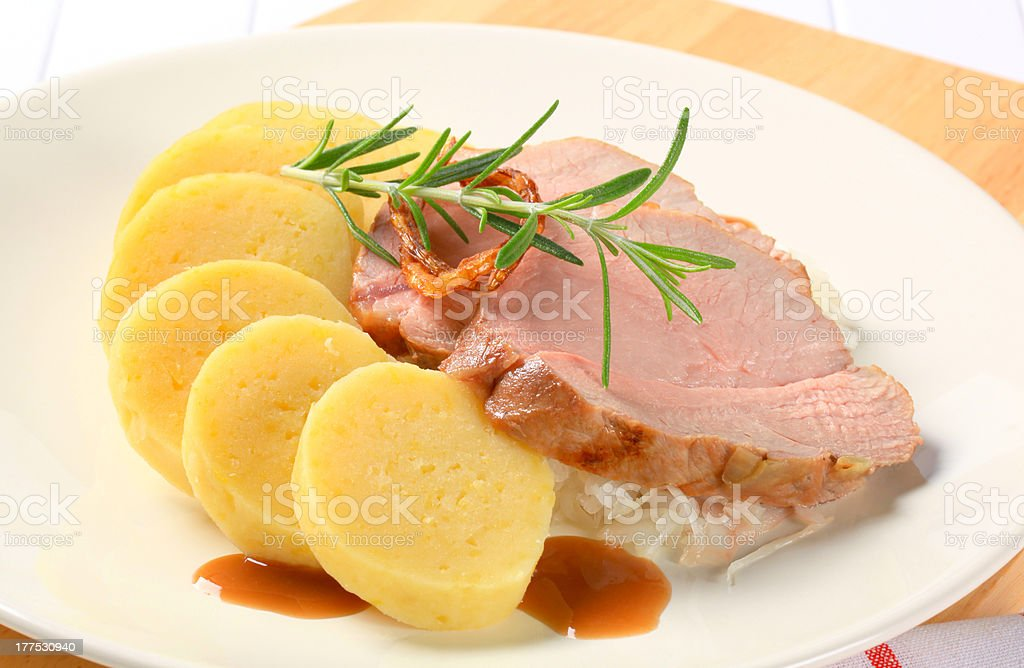 Pork with potato dumplings and white cabbage royalty-free stock photo