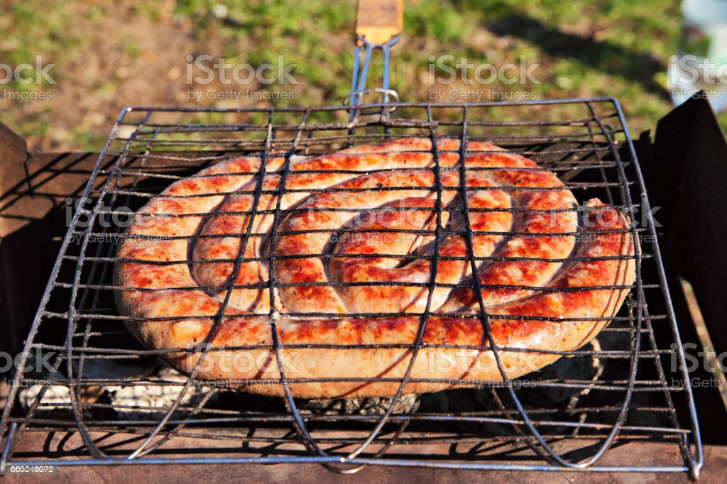 Pork wurst grilled on a coals. Sausages barbecue. stock photo