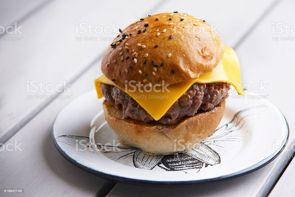 Pork,beef,burger with cheddar cheese stock photo