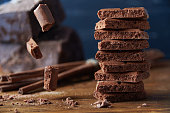 istock Porous chocolate and cinnamon on a wooden background 508338458
