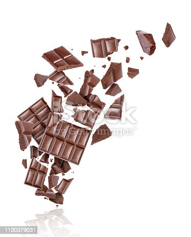 istock Porous chocolate broken into many pieces in the air, isolated on a white background 1130379031