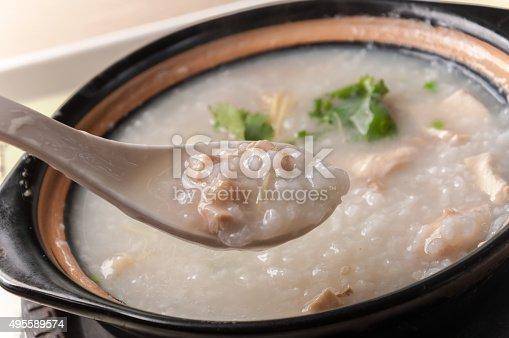 istock Porridge, abalone & chicken Porridge (congee) served in claypot 495589574