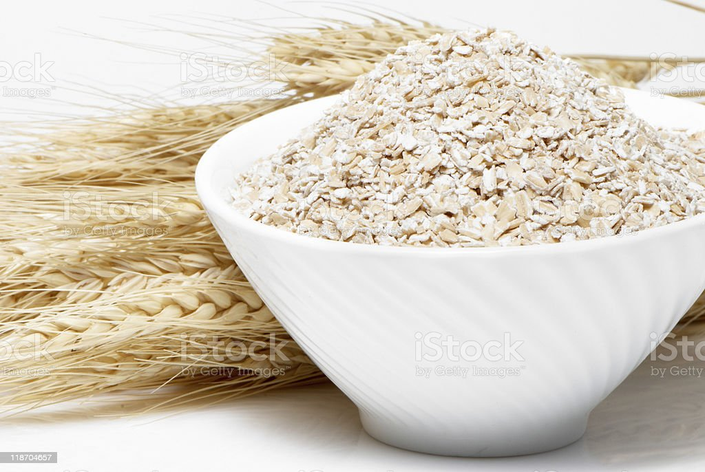 Porridge and Wheat ears on a white background stock photo