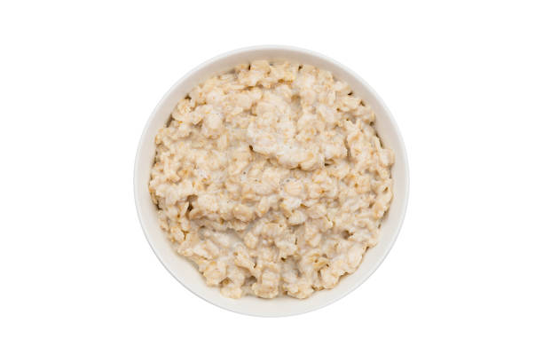 porridge oatmeal on a white background isolated porridge oatmeal on a white background isolated oatmeal stock pictures, royalty-free photos & images