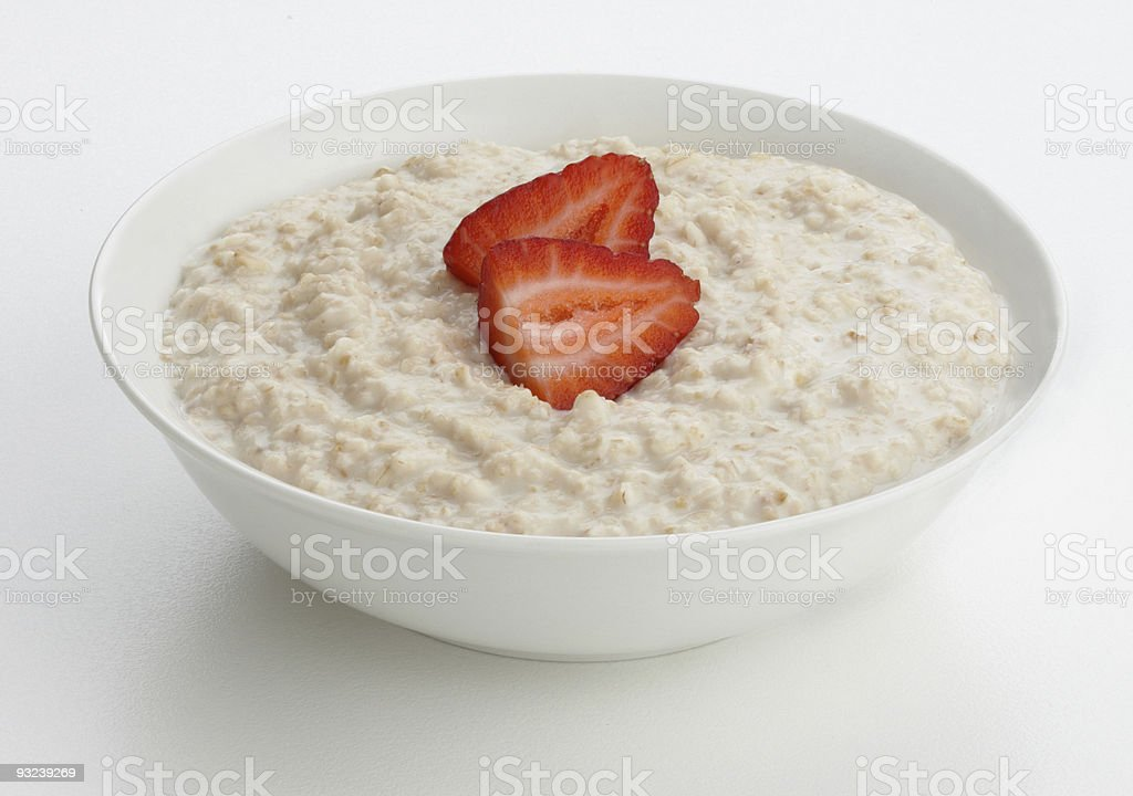 Porridge oats bowl with strawberry stock photo