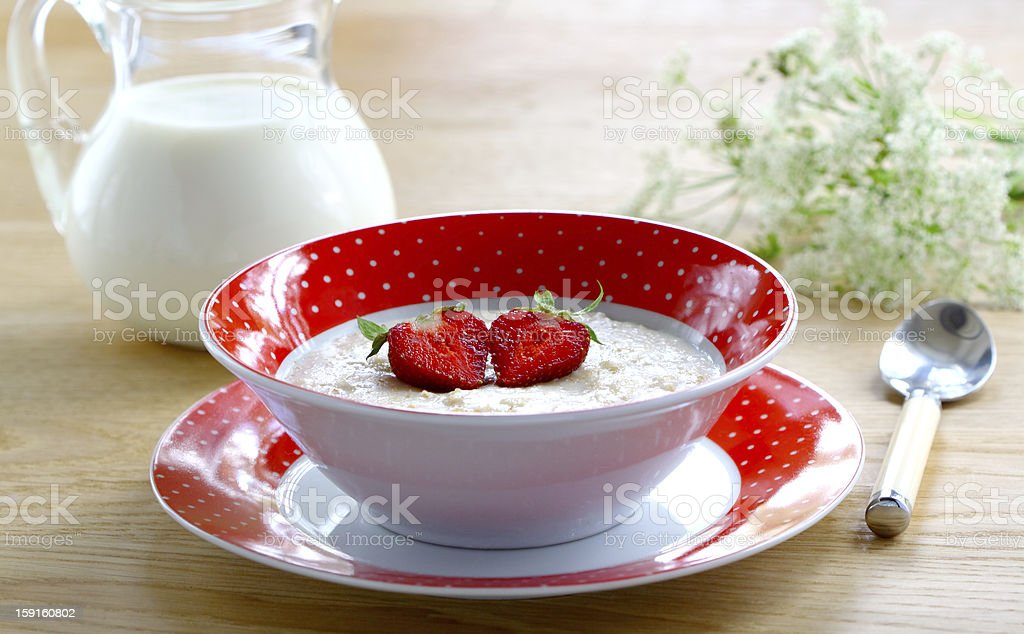Porridge with berries strawberry royalty-free stock photo