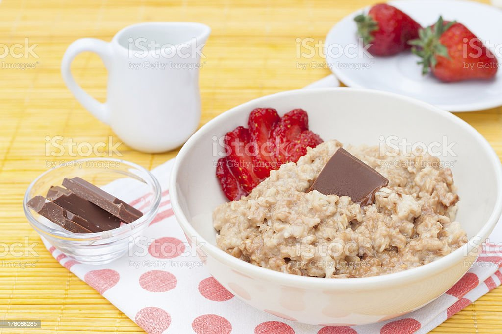 porridge with fresh strawberry royalty-free stock photo