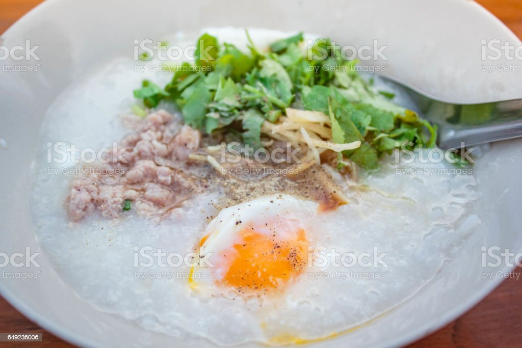 Porridge with pork and egg. stock photo