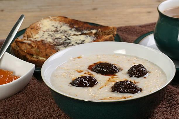 porridge with prunes stock photo