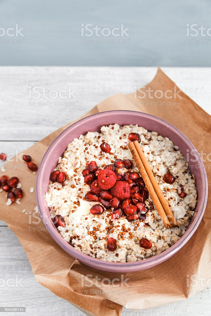 Porridge with quinoa and pommegranate stock photo