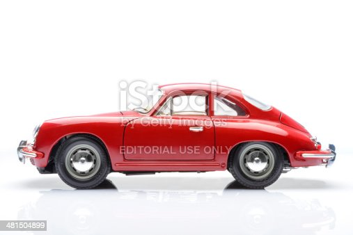 Kampen, The Netherlands - March 26, 2014: 1961 Red Porsche 356 B Coupe classic sports car model by Bburago isolated on a white background.
