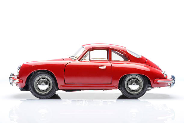 Porsche 356 Kampen, The Netherlands - March 26, 2014: 1961 Red Porsche 356 B Coupe classic sports car model by Bburago isolated on a white background. porsche stock pictures, royalty-free photos & images