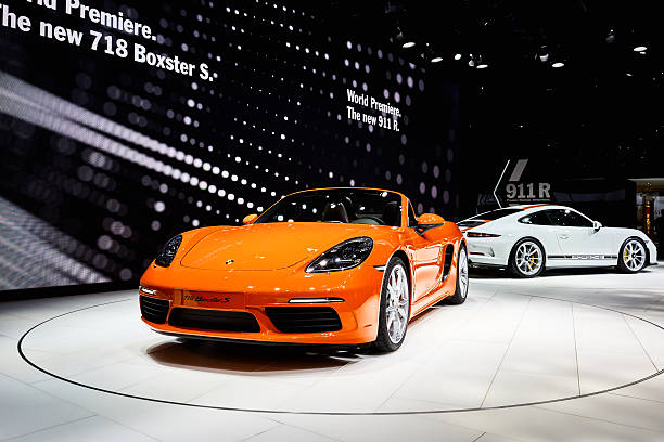 2016 Porsche 718 Boxster S Geneva, Switzerland - March 1, 2016: 2016 Porsche 718 Boxster S presented on the 86th Geneva Motor Show in the PalExpo porsche stock pictures, royalty-free photos & images