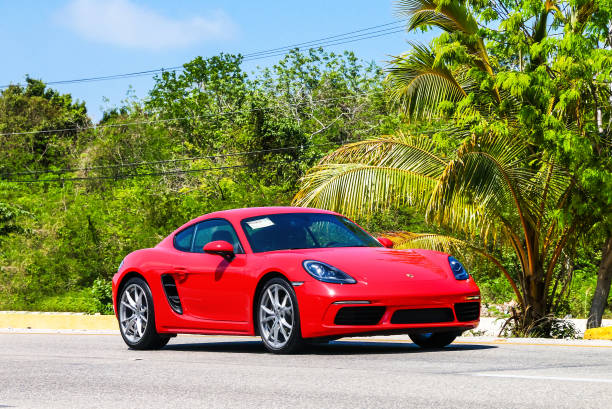 Porsche 718 Cayman Quintana Roo, Mexico - May 16, 2017: Motor car Porsche 718 Cayman in the city street. porsche stock pictures, royalty-free photos & images
